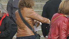 girl in brown leather jacket candid