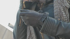 woman in leather gloves with leather jacket